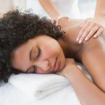 Gorgeous woman enjoying a shoulder massage at the health spa