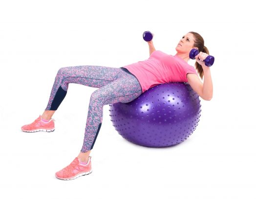 Woman exercise with a pilates ball