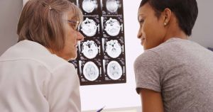 Senior Female Doctor Reviewing Xray Results With Patient